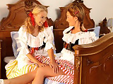 Traditional dressed sirens strip and have hot sex in bed