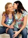 Beautiful lesbians undress lick and finger twats on sofa