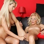 Sizzling blondes get naked and finger fuck twats on couch
