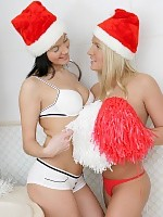 Cuties in Santa hats strip and dildo pussies in bathroom