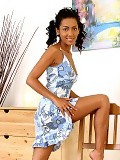 Tanned honey invitingly gets naked and poses in bedroom