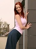 Fiery redhead teen strips and spreads pink pussy outdoors