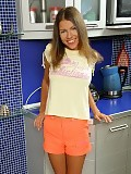 Brunette teen plunges cucumber deep into twat in kitchen