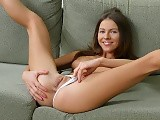 Horny brunette cutie dildos tight pussy and ass on couch