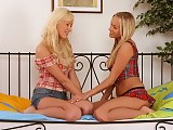 Gorgeous blondes lick and strapon fuck sweet pussies in bed