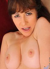 Alexandra Silk  Busty Alexandra Silk inserts a dildo deep inside her pussy
