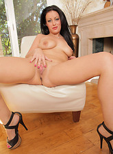 Angelica Raven  Angelica Raven gives her shaved milf pussy some needed attention