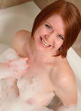 Ariana Carmine  Beautiful Ariana Carmine fingers her moist cougar pussy in the bubble bath