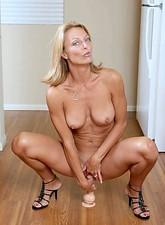 Brenda James  Orgasm starved busty milf bounces on her favorite dildo on the kitchen floor