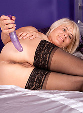 Glamorous Anilos milf Dana fucks her tender pussy with a purple vibrator