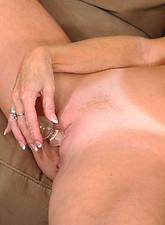 Darla Crane  Seductive brunette Darla Crane plunges a glass dildo deep inside of her cougar fuck hole