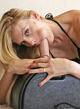 Darryl Hanah  Platinum blonde Anilos milf titty fucks the sybian dong before sitting on it with her glistening pussy