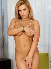Dorthy Black  Leggy long haired blonde Dorothy Black bends over in her white thongs exposing a tasty milf ass