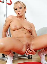 Eve Adams  After an intense workout Anilos cougar Eve Adams spreads her moist mature pussy
