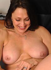 Jillian Fox  Nymph milf Jillian Foxxx spreads her pussy while stroking her silver toy in her twat