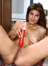 Voluptuous Anilos cougar mom deeply drills her aching milf pussy with a red vibrator in the kitchen