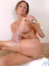 Montana Skye  Anilos Montana Skye gets her nude body in the bathtub and sprays her pussy with the shower head