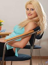 Nicoletta Blue  Classy blonde milf nicoletta strips off her clothes revealing her silken flesh