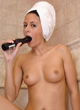 Nikki Daniels  Anilos Nikki Daniels shaves her pussy and fucks a black vibrator
