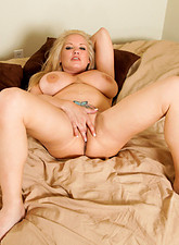 Rachel Love  Busty Anilos Rachel Love shows off her huge tits and plays with her mature pussy