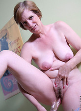 Ray Lynn  Anilos old lady gets horny and she fucks herself in both holes with the rabbit and a vibrator