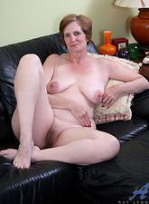 Ray Lynn  Anilos granny Ray Lynn looks great as she masturbates with her powerful silver vibrator