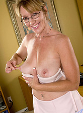Samantha Stone  Naughty secretary peels off her clothes and pleasures her milf pussy with a vibrator