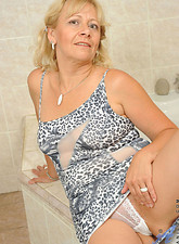 Sabrina West  Busty granny fucks her mature pussy making herself wet in the bathroom