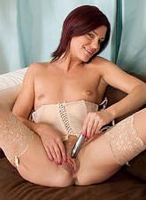 Sofia Matthews  Horny redhead Sofia Matthews fucks her milf pussy with a silver vibe