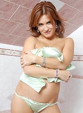 Valentina Rush  Mature redhead Valentine Rush stretching her panties in between her two legs
