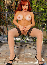 Vanessa Bella  Horny milf Vanessa Bella satisfies her mature pussy with a sex toy outside
