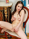 Tempting nubile babe Adalyn undresses and inserts her fingers in her luscious hot pussy
