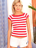 Innocent teen wearing cute stripe shirt slides it off and showing her cute tits
