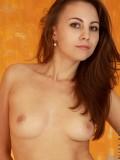 Teen hottie slips off her panties and bends over to flaunt her slick pussy