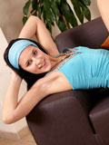 Cute alluring teen display her perky juicy tits on couch