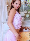 Naked teen amateur Anina gently caressing her pink pussy in a wierd pose