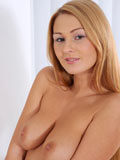 Long haired Nubile Antonyia totally naked while fingering her tight pink pussy on the chair