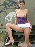 Wow hottie outside flashing her small tiny titties with whacked out grafitti in the background