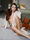 Sweet teen nubile celeste hangs out naked with her teddy bear caressing her boobs