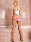Stunning blonde nymph temptingly drills her moist pussy with the rabbit toy in the bathroom