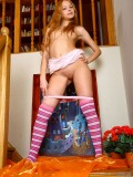 Captivating steamy nubile Dolly looks great as she exposes her precious teen assets on the stairway