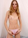 College girl taking off her shirt and flashing her boobs