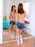 Sweet redhead slides off her thongs and masturbates with the magic wand