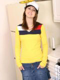 Sweet teen in a truckers cap and a tight yellow top looks hot