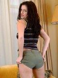 Seductive brunette teen rubs her moist pussy