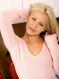 Blonde teen in red panty giving a sweet seductive look while posing for the camera