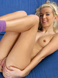 Cute titted blonde fucks a stripey cute dildo inside her pink pussy