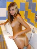 Cutie katrina plays in the bathtub letting the water run down her tight body