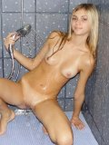 Fuckin hot teen sits and plays with the water in the shower