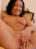 Alluring Nubile Kesare strips off for the first time and gently fingers her tight pink pussy